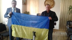 State Service for War Veterans and ATO handed a flag and thanks for helping fighters on the front