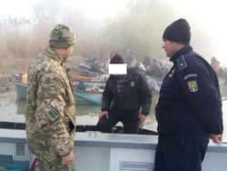 Ukrainian and Romanian border guards on the boat had joint patrols Danube
